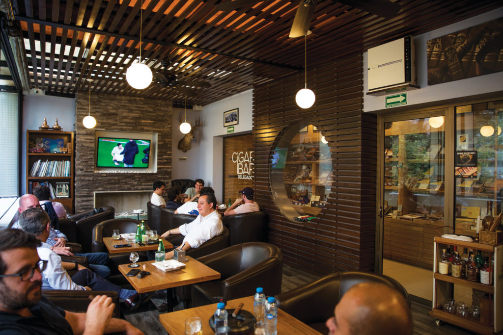 Cigar Bar Delegados in Polanco is a terrace lounge with a red phone booth entrance