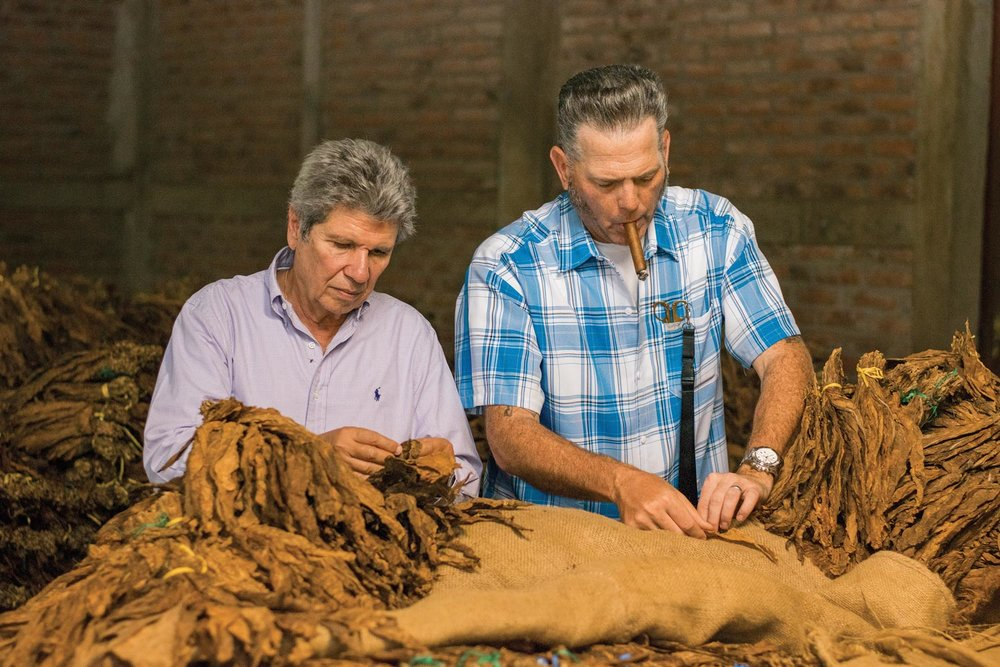 Aganorsa founder Eduadro Fernández (left) and Illusione founder Dion Giolito inspect Aganorsa tobacco together in Estelí.