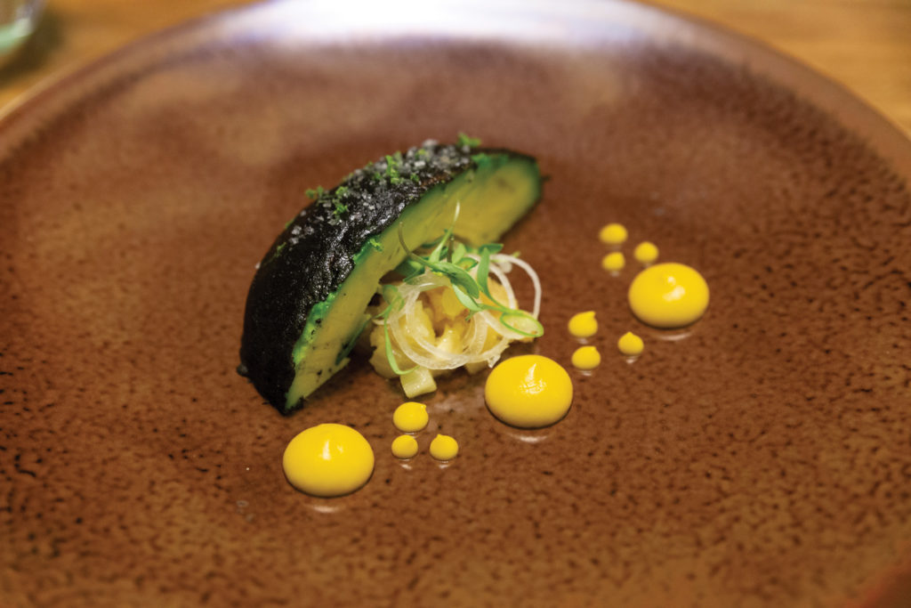 Dishes on the tasting menu at Quintonil (an avocado with a blackened chile crust) Mexico City