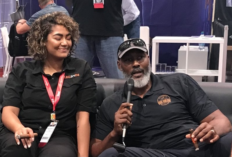 Karl Malone talks about his new cigar — Barrel-Aged by Karl Malone — with his daughter Kadee, who is co-owner of Legends Cigar and Vape in Ruston, Louisiana.