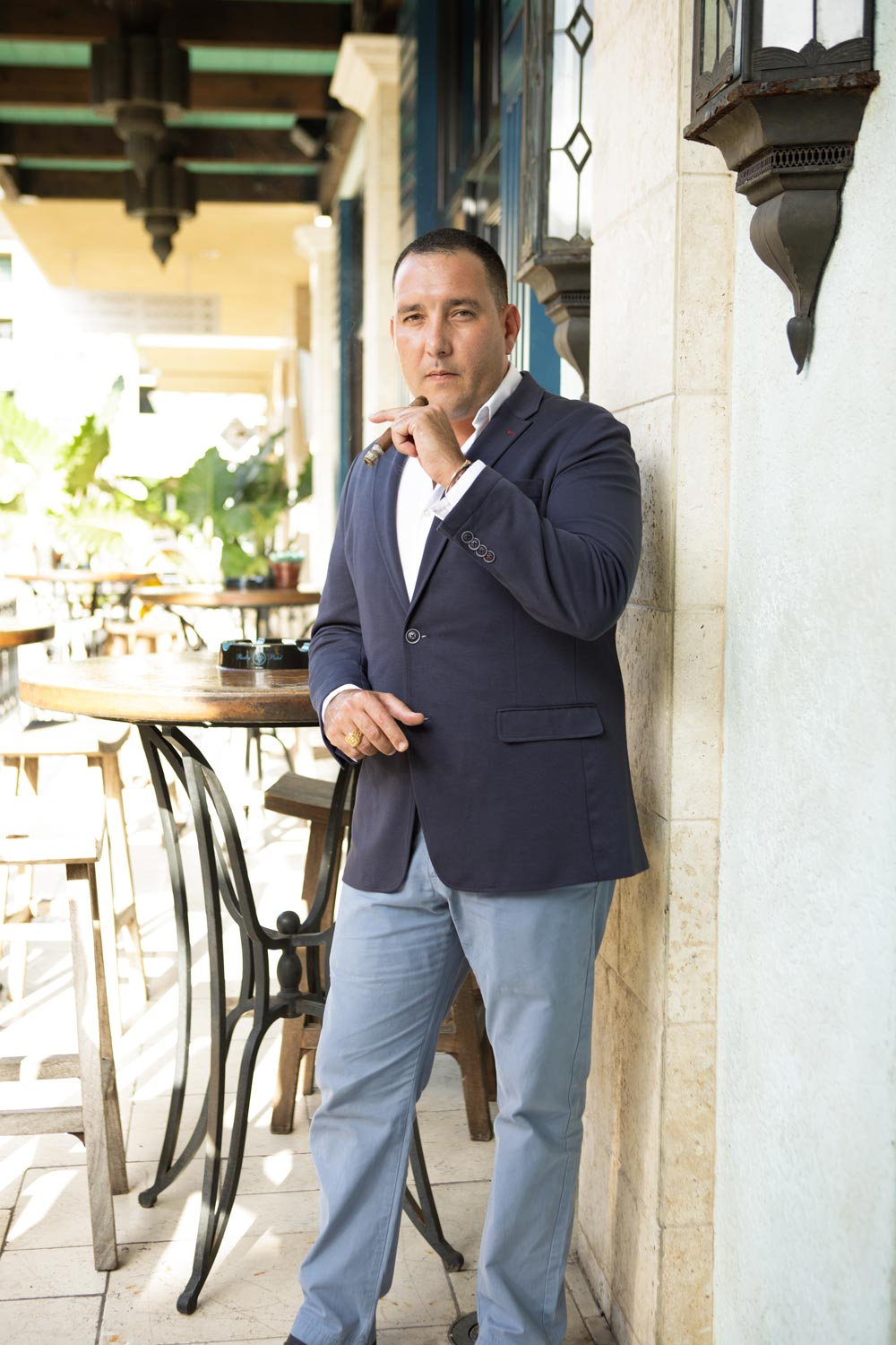 Hamlet Paredes smokes a 25th Year outside Burn, Rocky Patel's Naples, Florida cigar bar.