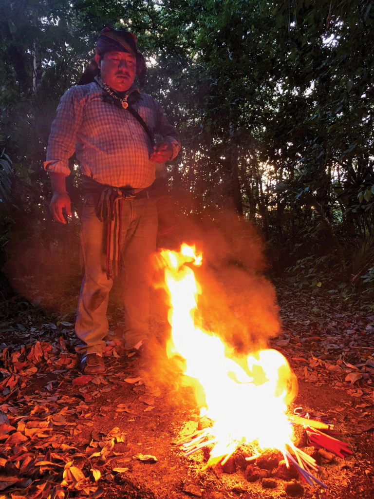 The shaman reads the flames during this Mayan ritual.
