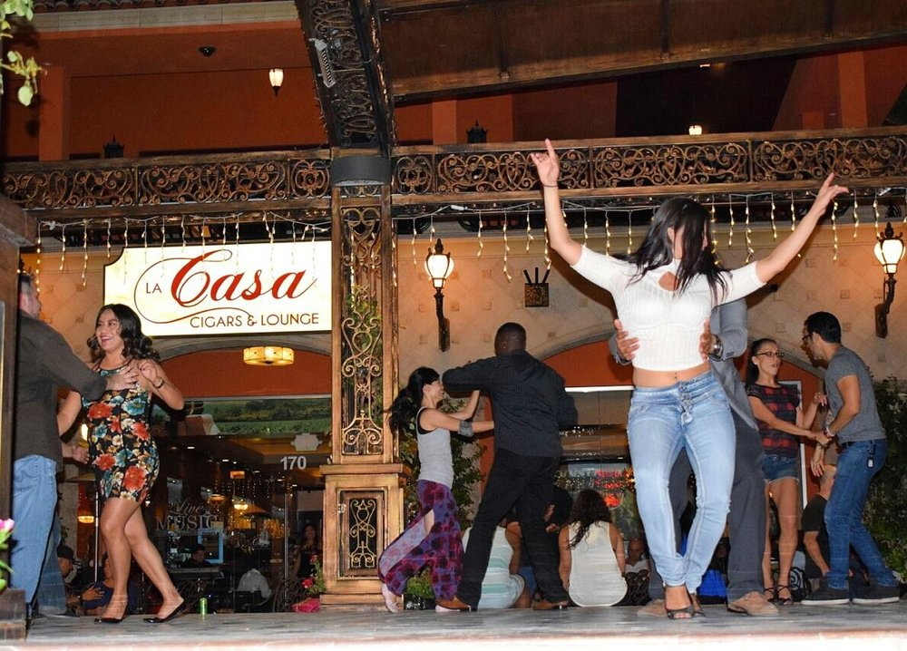 Guests dancing to salsa music at La Casa Cigars & Lounge in Summerlin