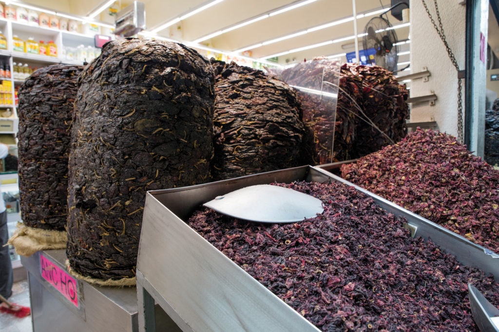 mountains of dried peppers at La Central de Abastos Mexico City