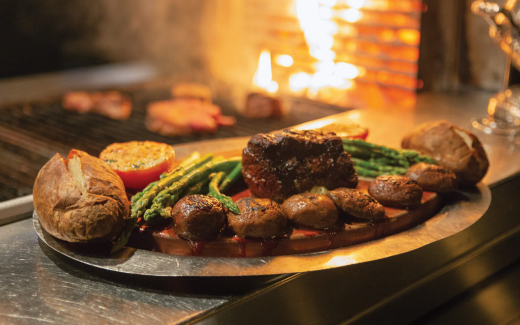 steaks are cooked over charcoal at El Gaucho